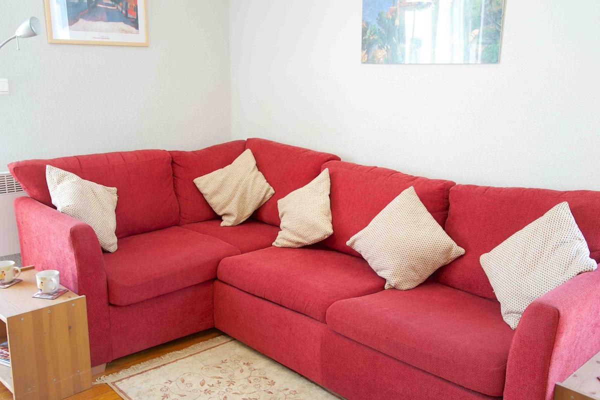 Comfortable seating area with TV so you can keep in touch