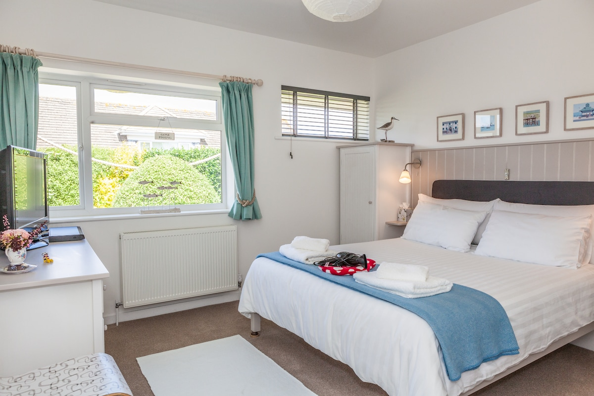 """Guest Wing Bedroom (1) showing hairdryer, 32"""" TV & DVD. Invite your friends to stay at £30 p.p.n 2 night minimum."""