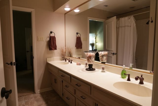 The guest bathroom, located off the guest bedroom and the TV room.