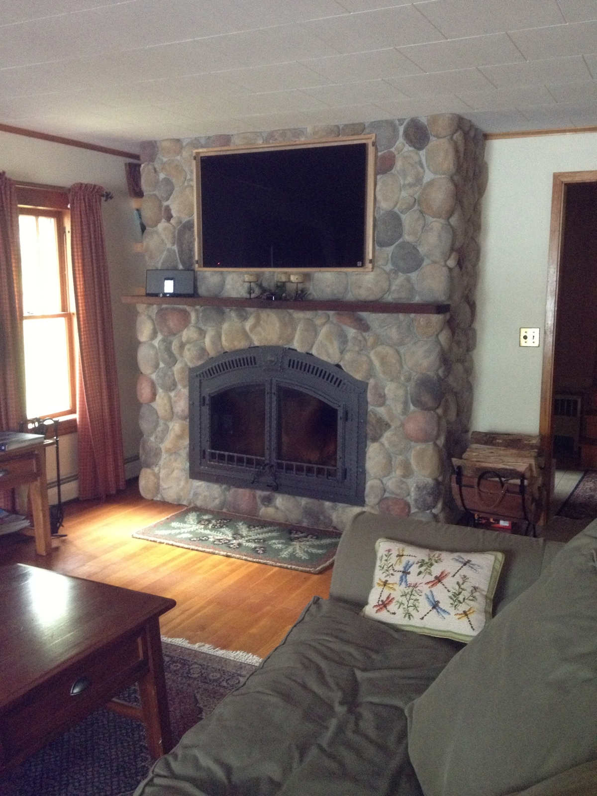 Wood burning fireplace with TV over mantle