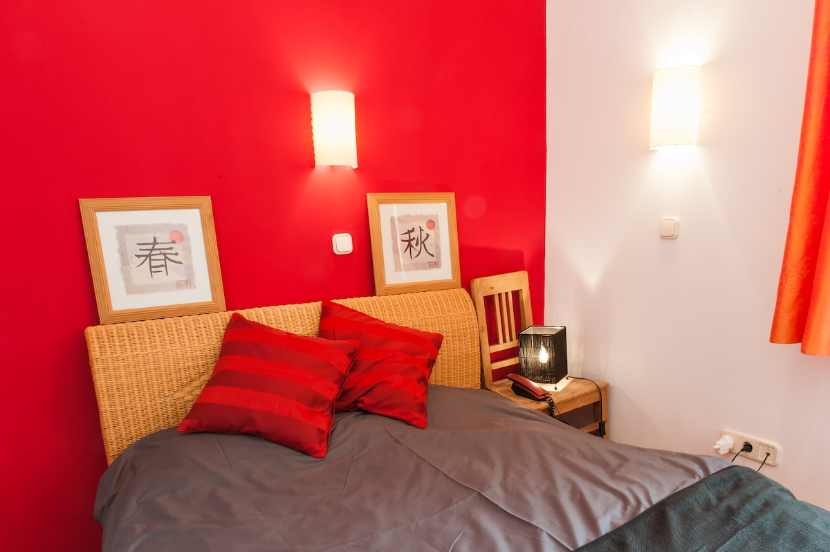 The downstairs bedroom (it is wine coloured, not actually red!)