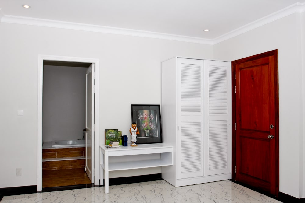 The door to your extra large private bathroom, your closet and a vanity