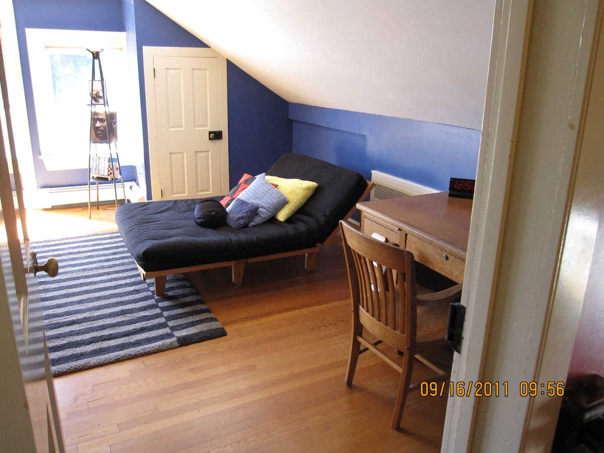 double futon in room with queen bed