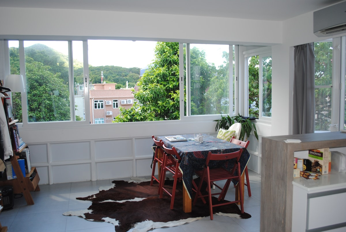 Spacious and bright sitting room/dining room, please note floor pillows are used instead of a couch!