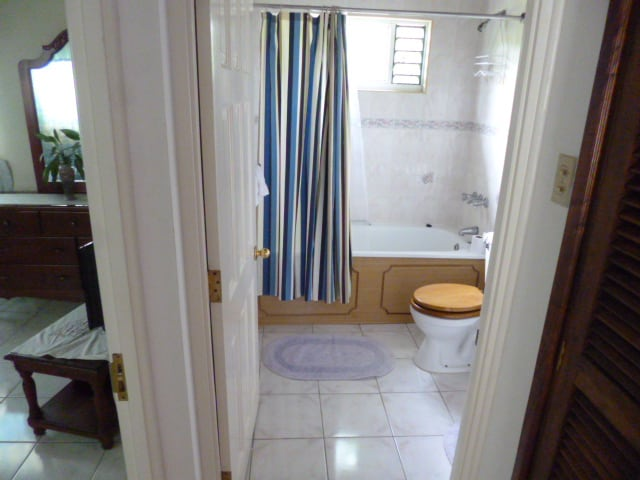 Ensuite, view into bedroom and storage shown.