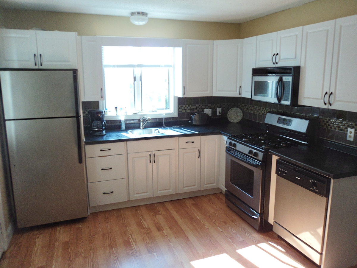 Full Kitchen with dishwasher and gas stove.