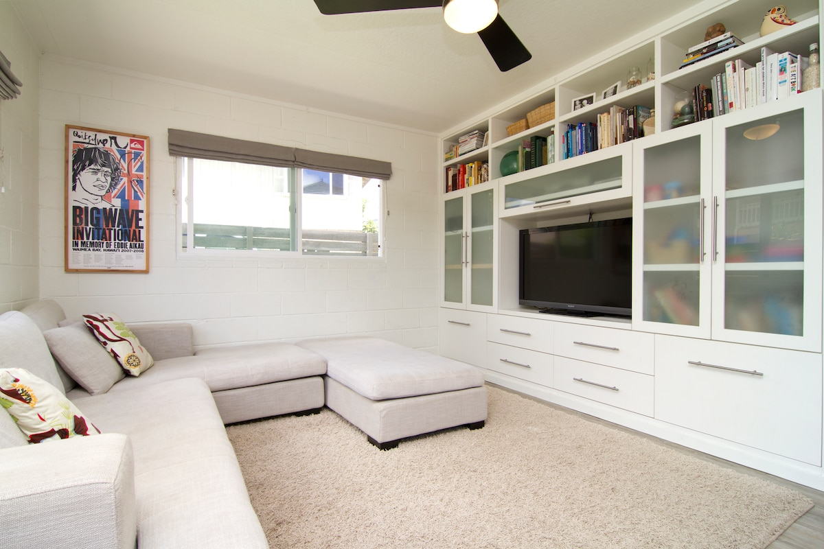 Modern living area with large sectional couch.