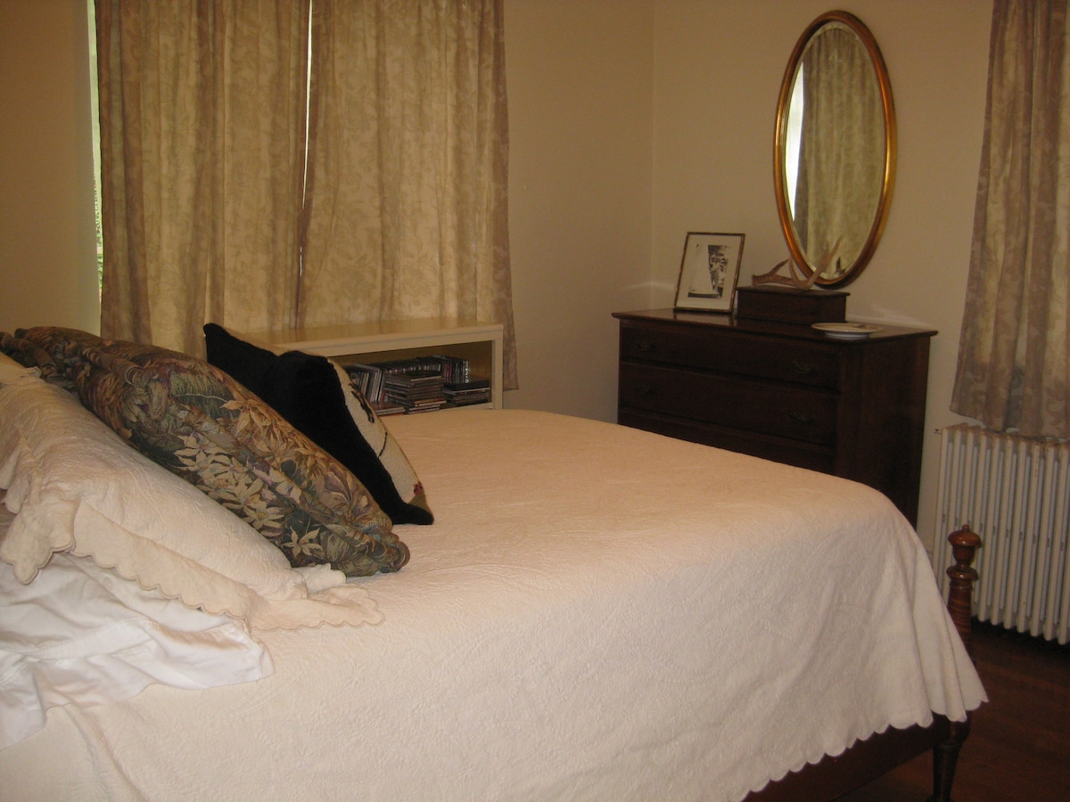 Your room! Full sized bed with new mattress, cotton bedding, space made available in the dresser and closet for long stays!