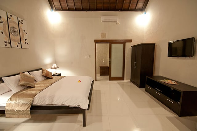 Bedroom with AC, fridge, TV and wireless