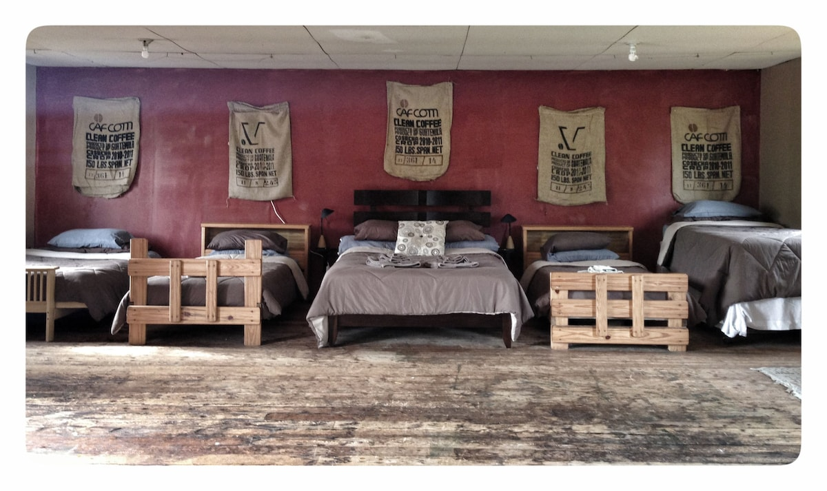 The beds in the loft include 3 twin, 1 double, and 1 queen.