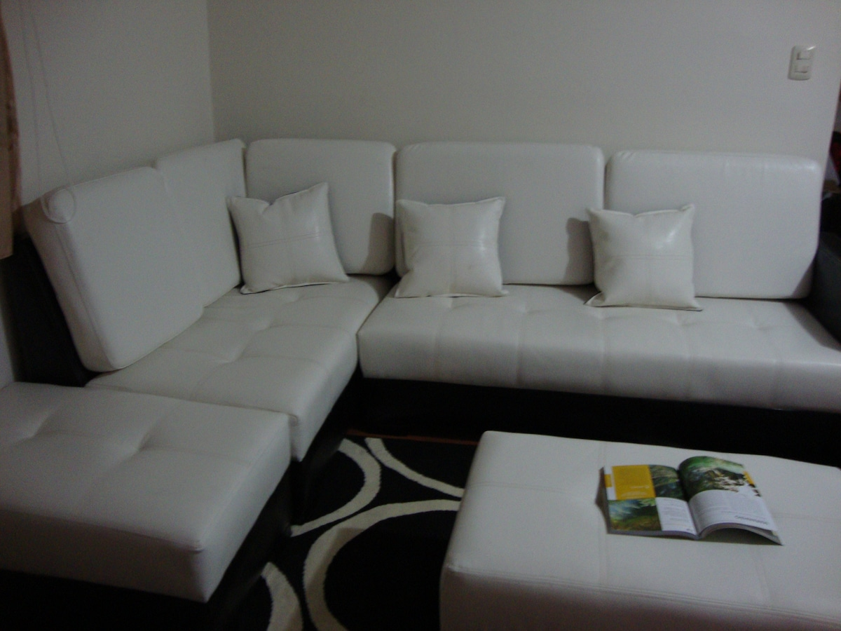 The couch where you can watch the TV and  see the view by the screen.
