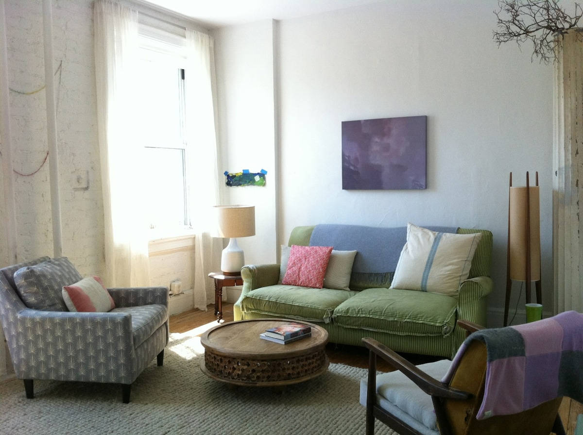 Living room with beautiful southern light  & views all the time of downtown Manhattan