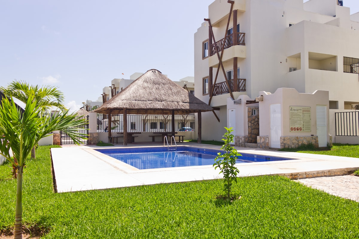 Green Area by the Swimming Pool + Charcoal Grill