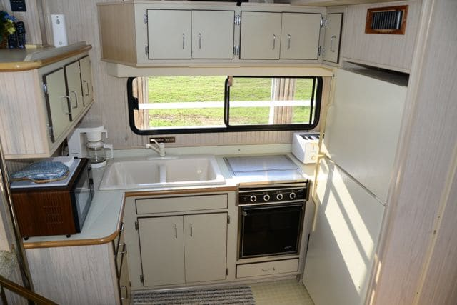 "The kitchen, or ""galley"", has a range, full size refrigerator, microwave ovens, and all the accessories you will need."