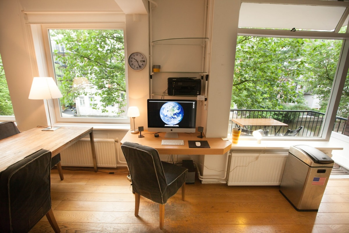 The Apple iMac is yours to use! And check out the balcony too...