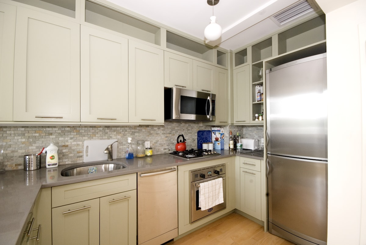 spacious and fully-stocked kitchen