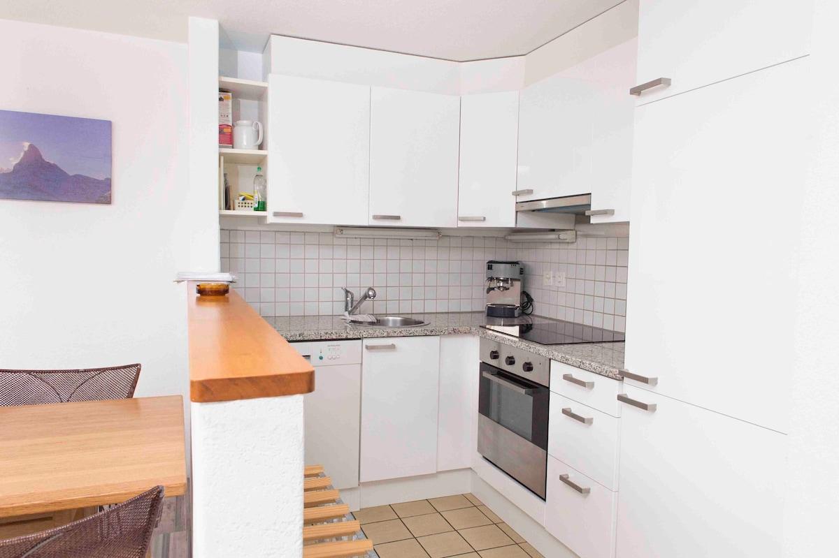 Open kitchen with dish washer, coffee machine, fridge etc. Nice granite cover.