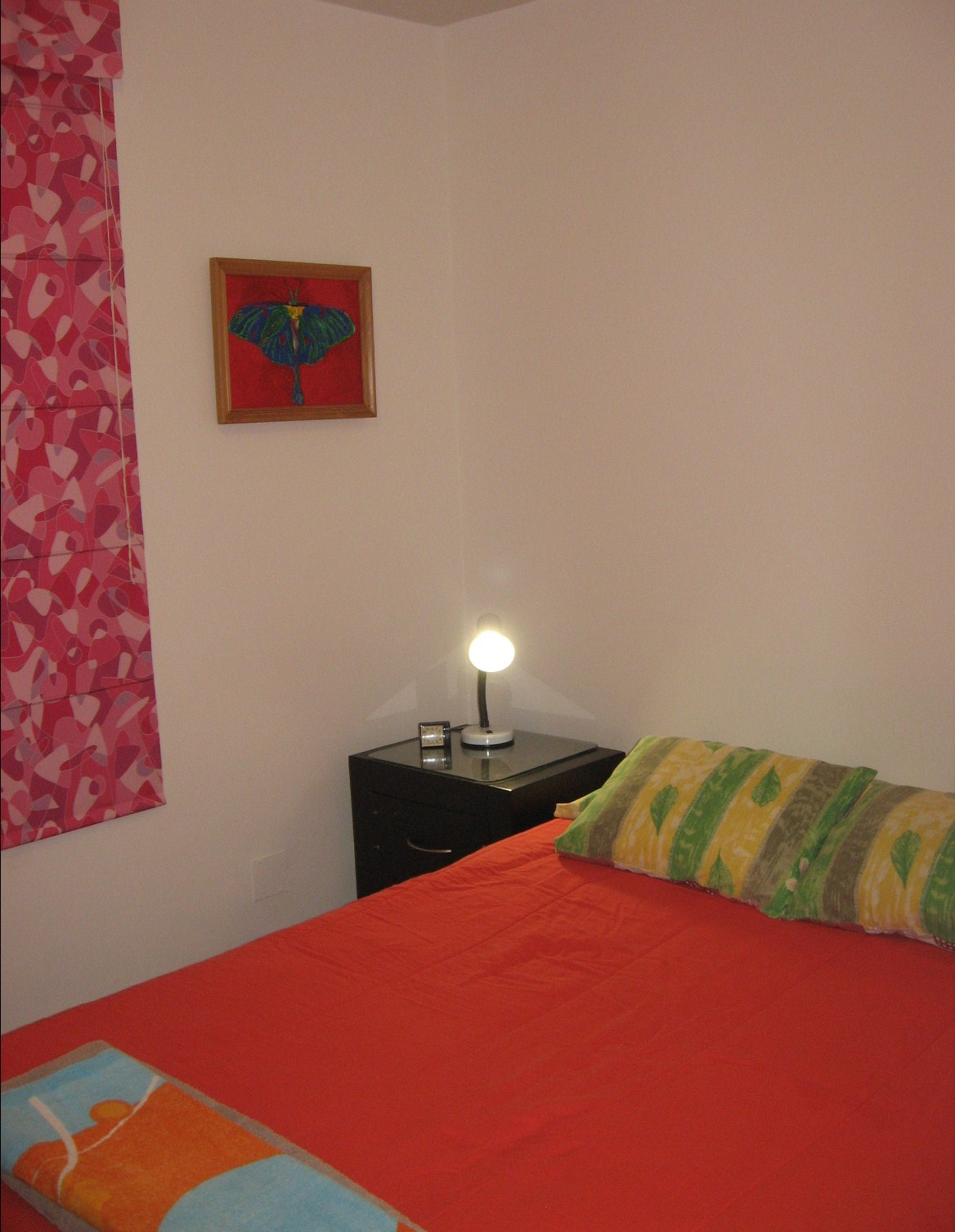 Full size bed, night table, lamp
