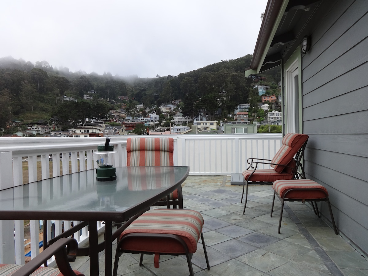 Private deck with views of our Pedro Point neighborhood, coastal mountains and the Pacific Ocean.