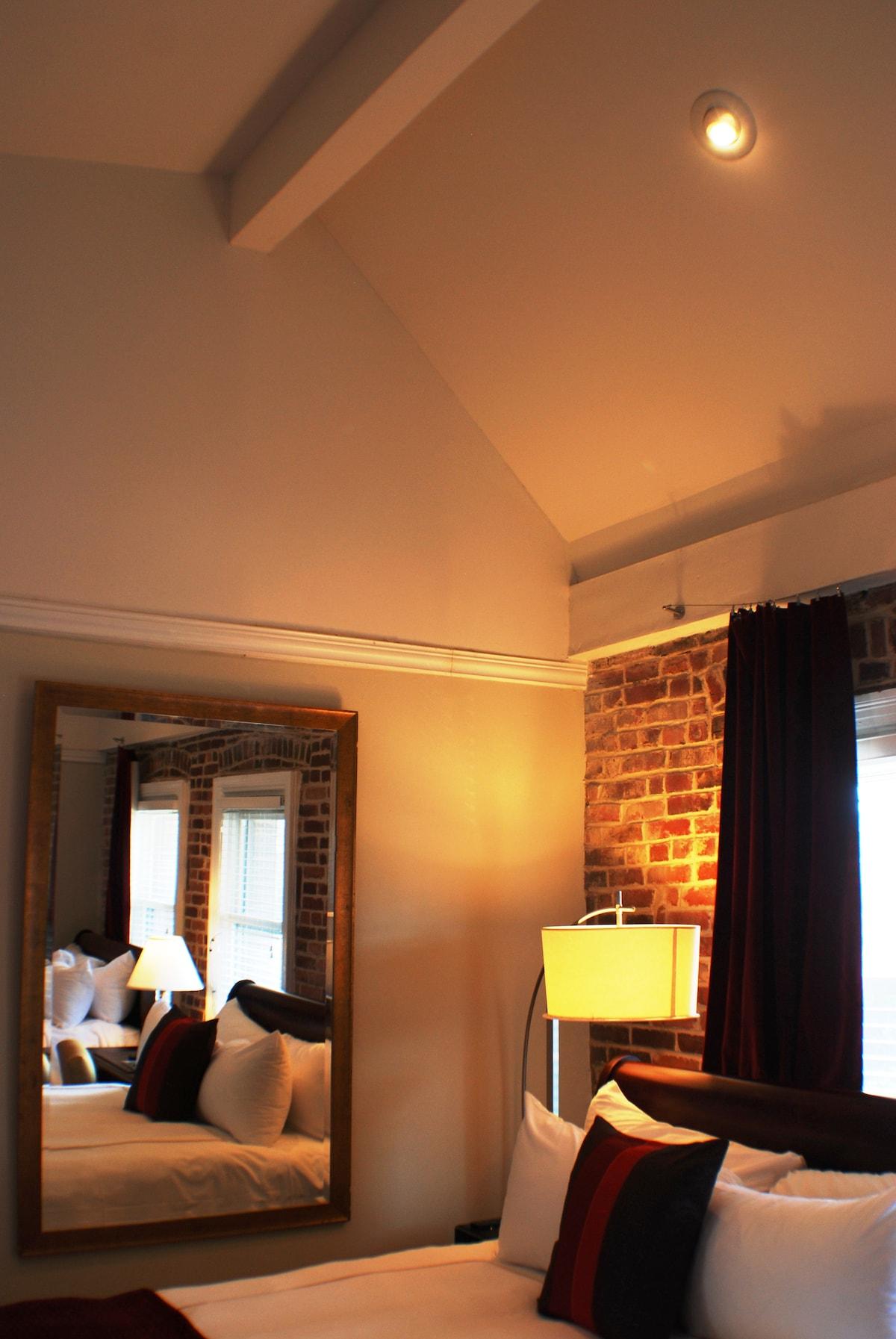 Exposed brick walls in bedroom