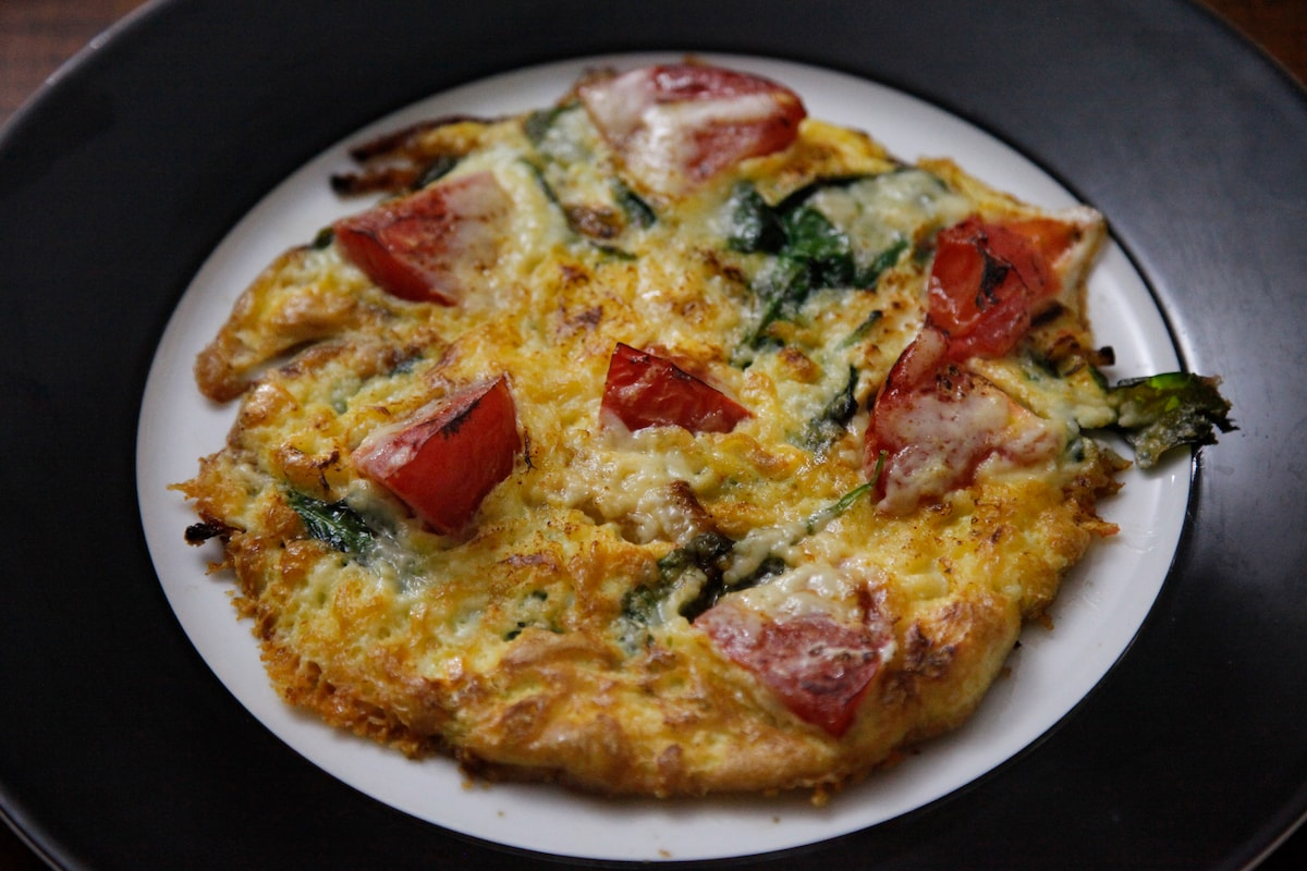 Frittata with tomato, onion, basil and four cheeses.