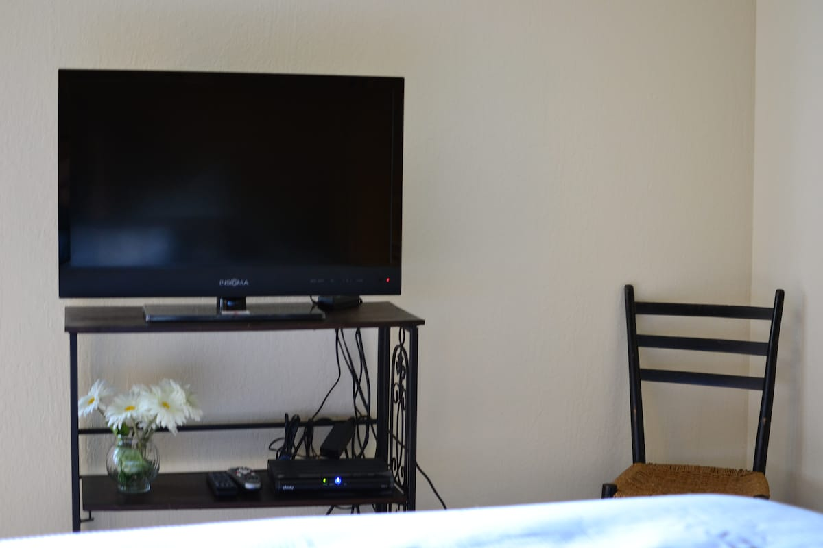 Cable TV, DVDs in front of Bed