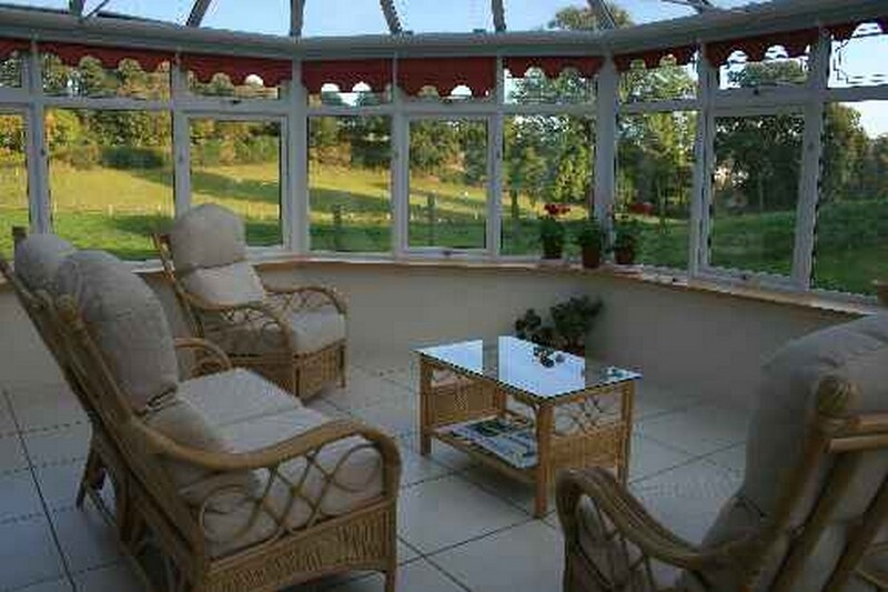 Our very spacious conservatory with wonderful views - maybe for breakfast or to enjoy later in the day, or evening.
