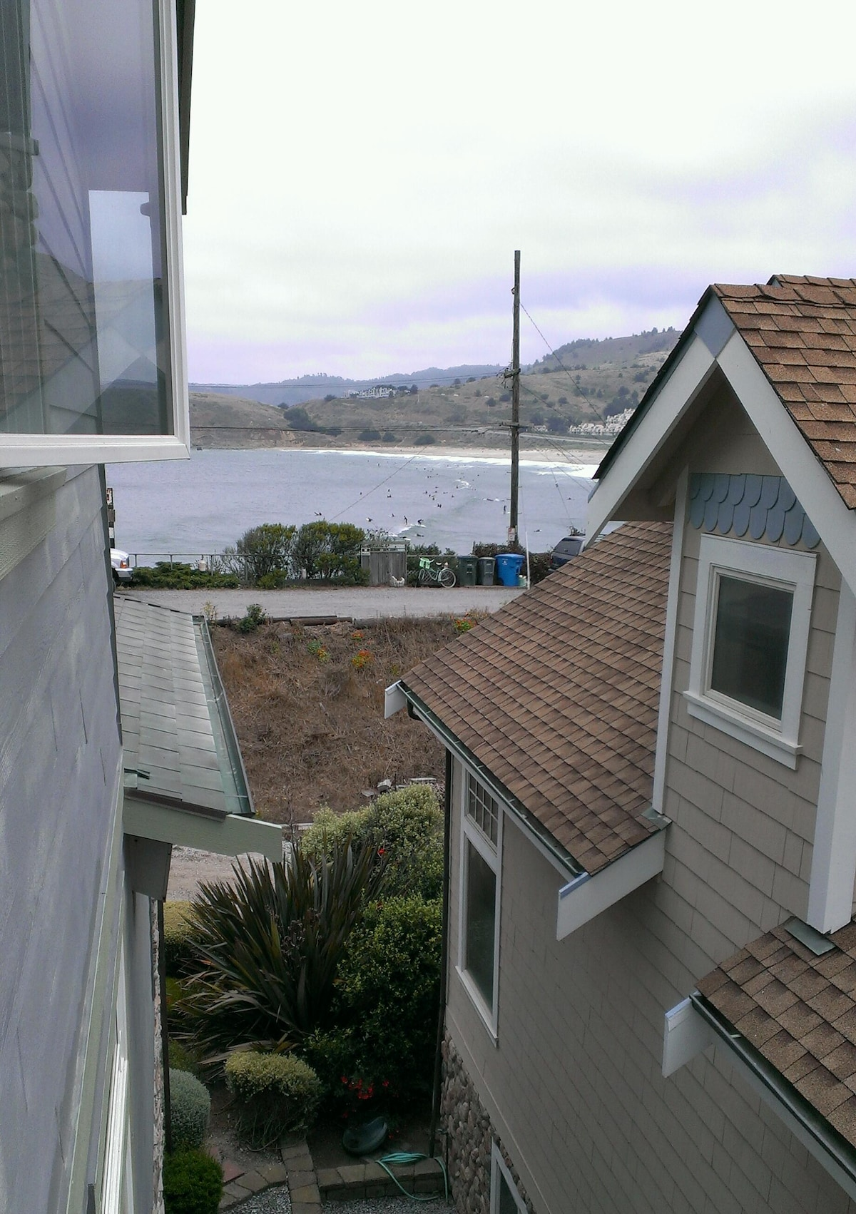 View from the deck, Pacific Ocean and Linda Mar Beach, a popular surfing spot.