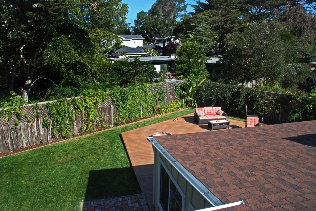 Spacious fully fenced in backyard with a redwood deck and outdoor jacuzzi