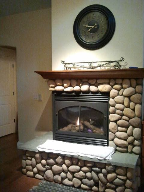 Sit for a while on the hearth of the two sided gas fireplace to take away the chill on cool nights.