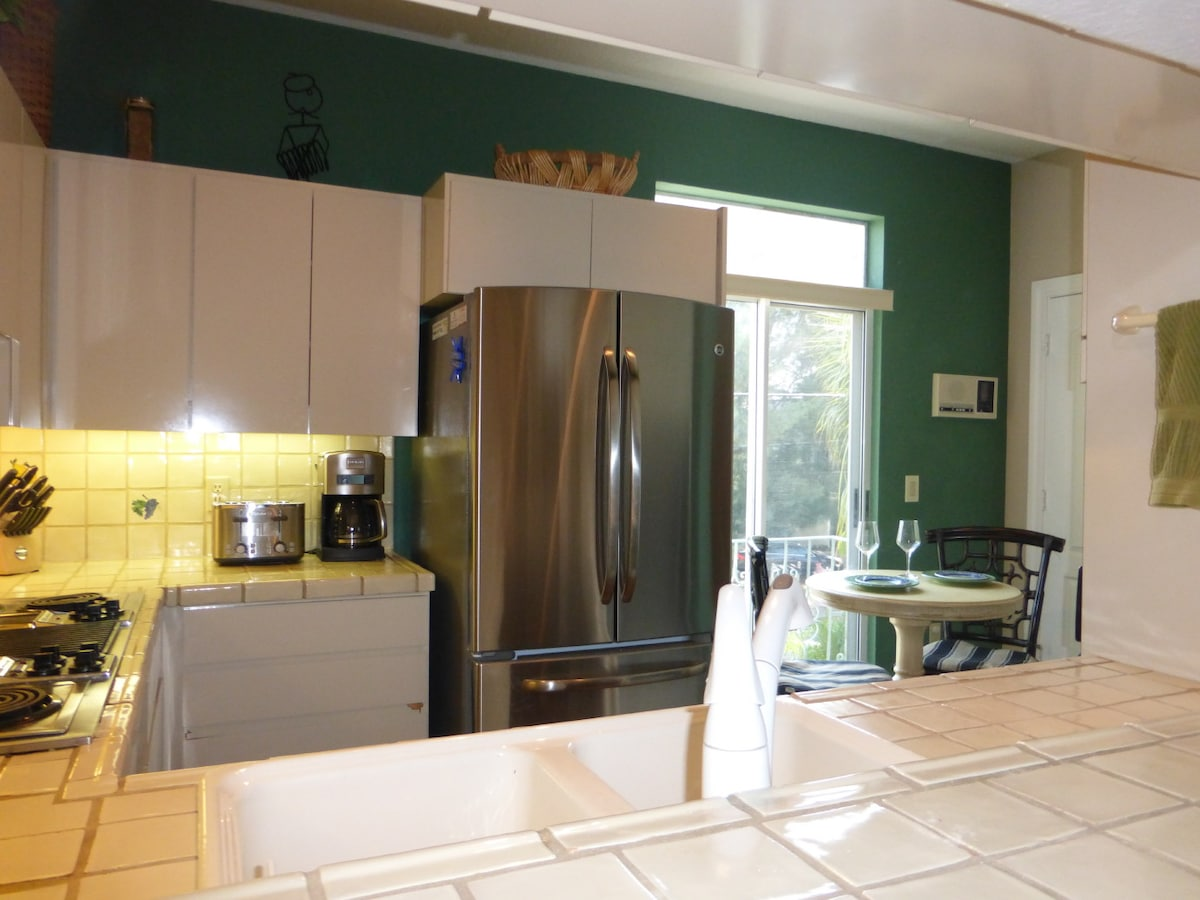 Totally stocked kitchen with stainless steel appliances and breakfast nook.