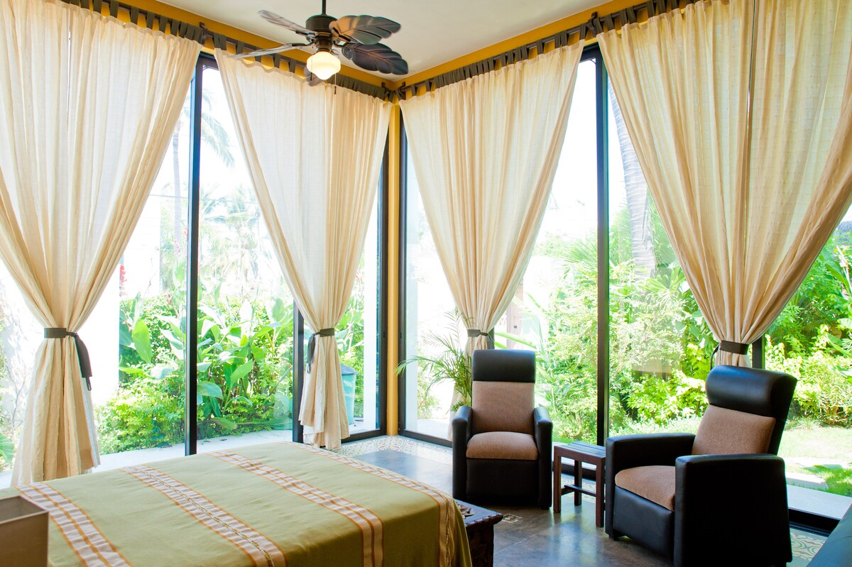 Close the drapes for privacy, or slide open the doors to the garden