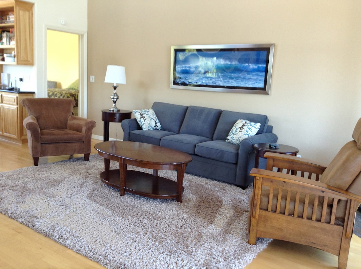 Comfortable seating area enhanced by Robert Knight's seascape of the Monterey Bay.