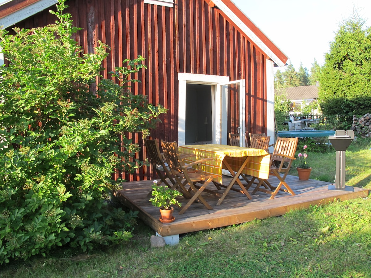 Wooden deck towards South with a sharecoal grill , outside bed room