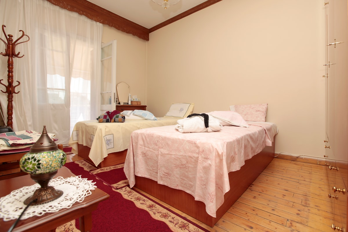 Spacious bedroom with two single or one double bed, according to your wishes