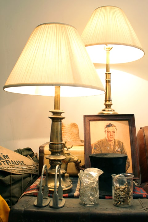I collect art objects and heirlooms. That good looking fellow is a portrait of my Grandfather from 1945 in Berlin. The top hat belonged to my great great Grandfather from Italy.