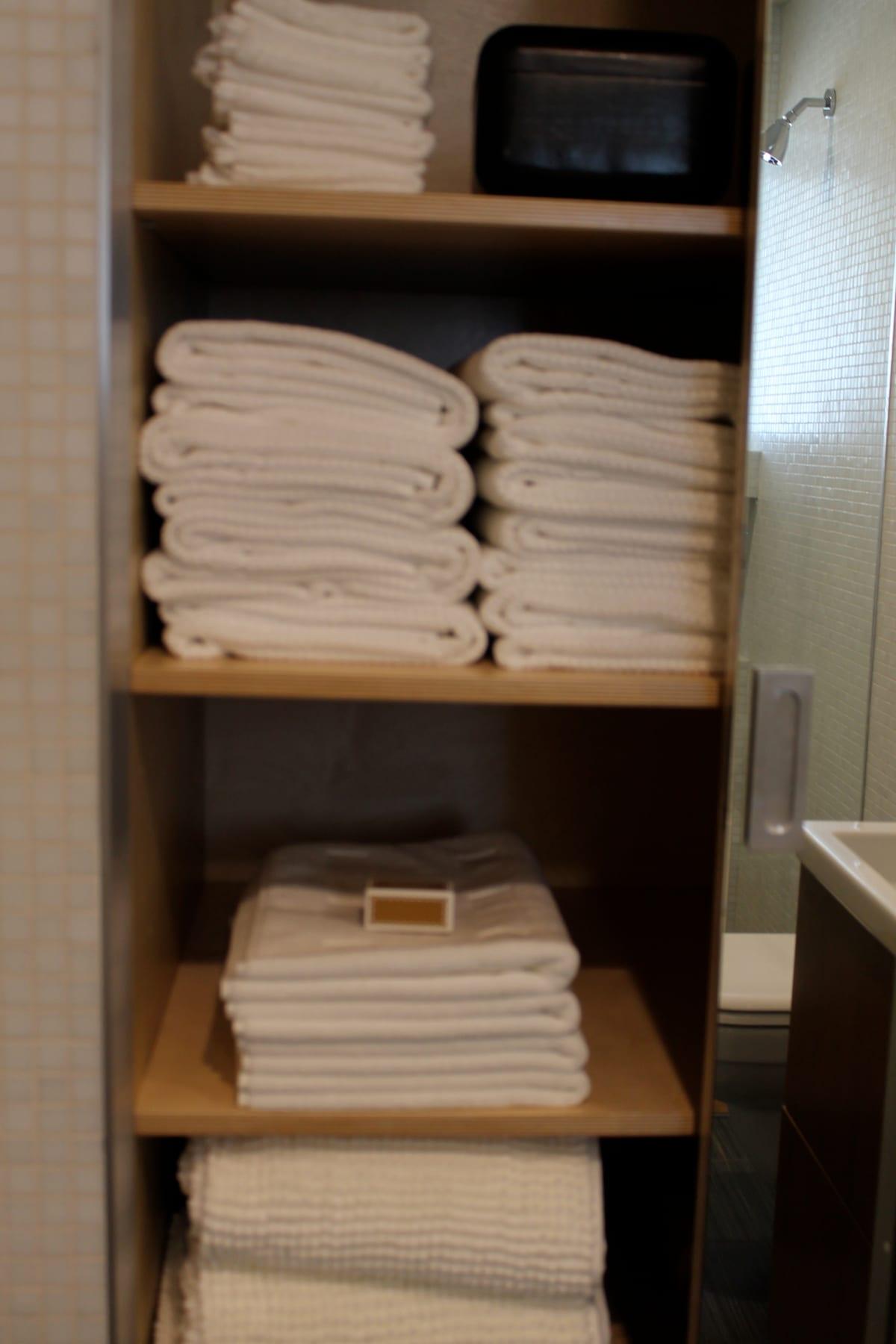 Plenty of clean towels and bath mats