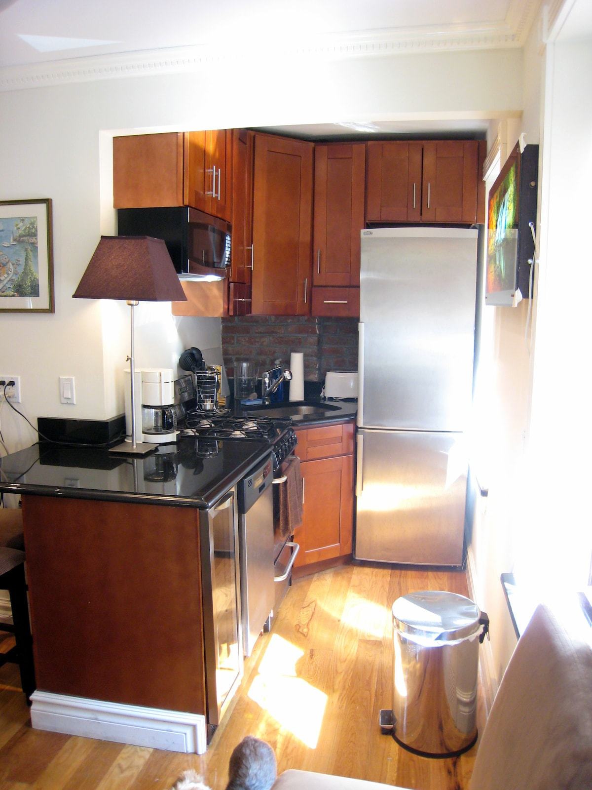 Kitchen with microwave, dishwasher, stove, oven and all cooking utensils and dining needs for preparing meals