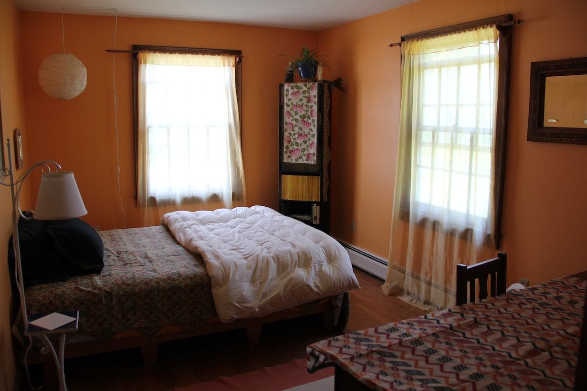 The upstairs bedroom. This bedroom has a shared full bathroom.