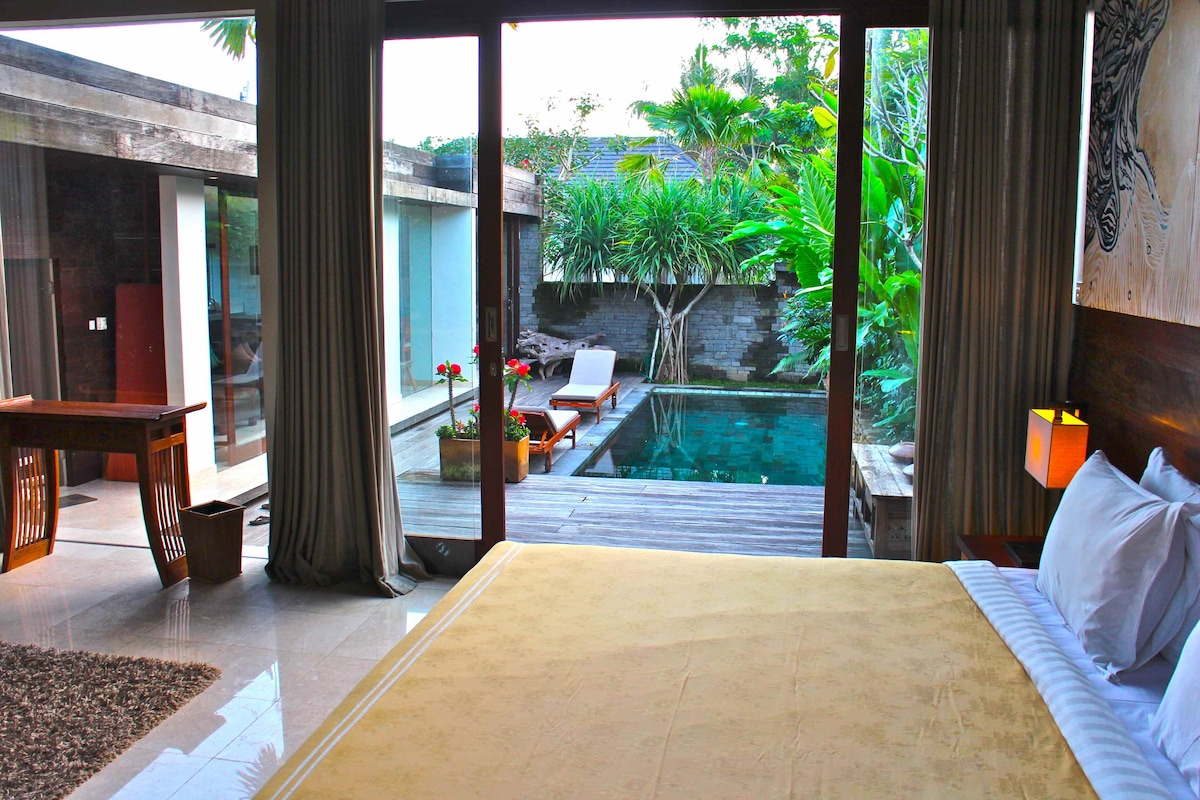 View from master bedroom overlooking the pool. Curtains can be opened or closed for privacy.