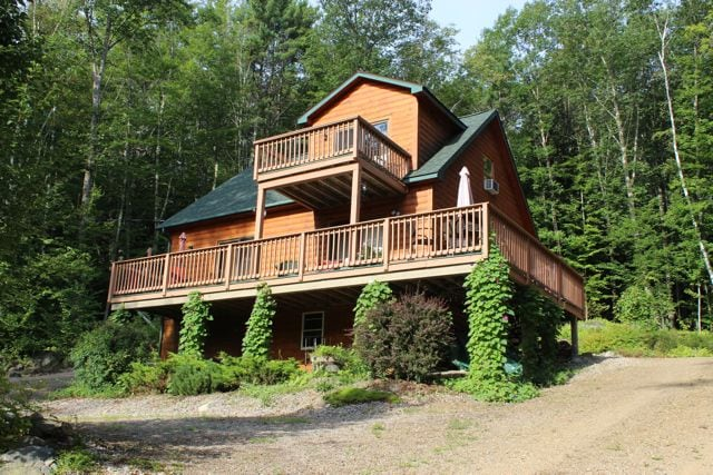 Beautiful Log Home with wrap around deck and Master bedroom balcony.
