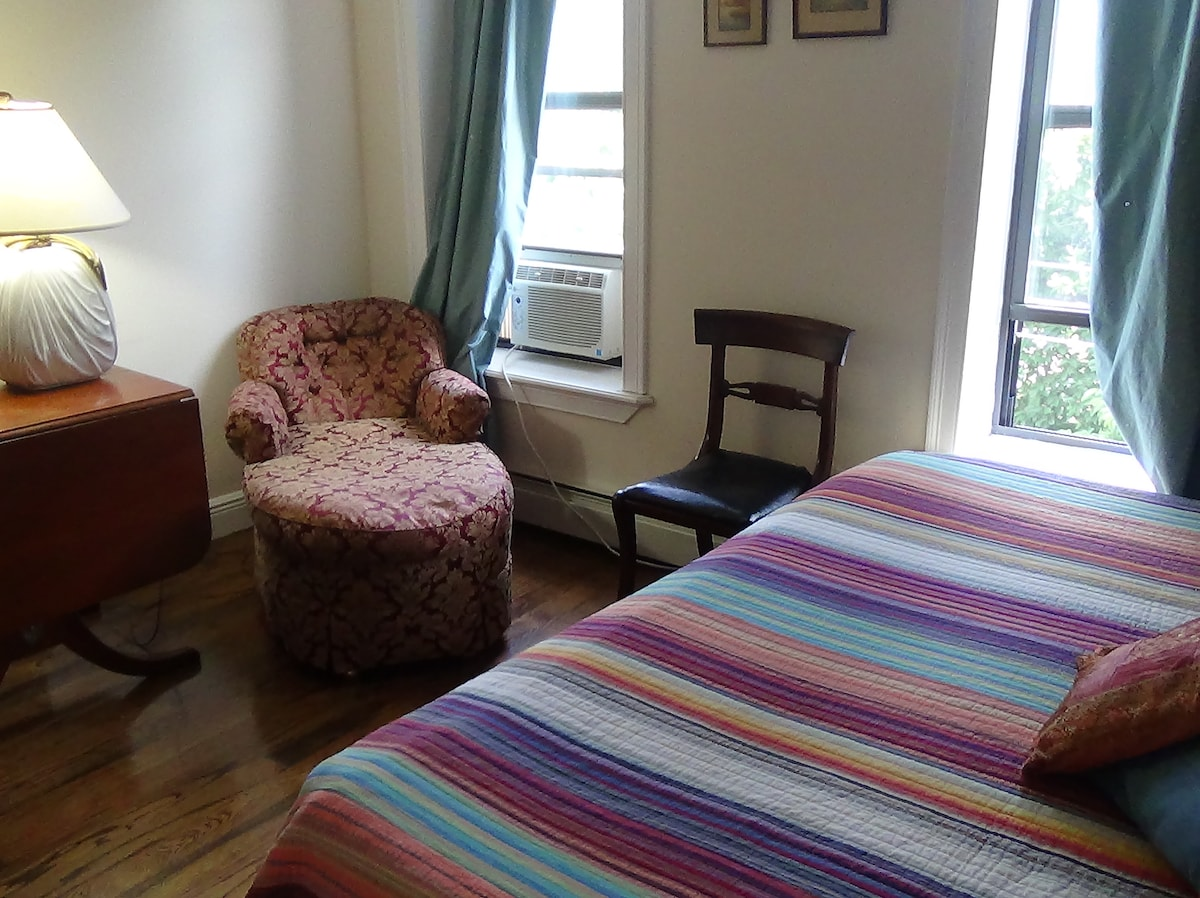 Queen sized bed, room air conditioning, and comfortable seating make for a restful getaway..
