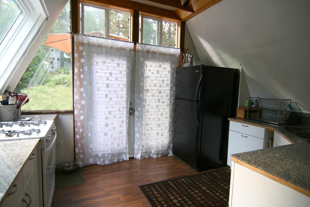 Kitchen with gas range, microwave, garbage disposal and fridge/freezer