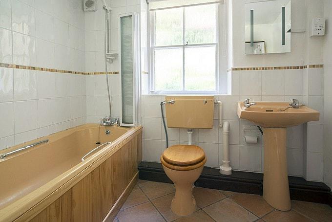 The bathroom has underfloor heating to keep the tiles cosy.