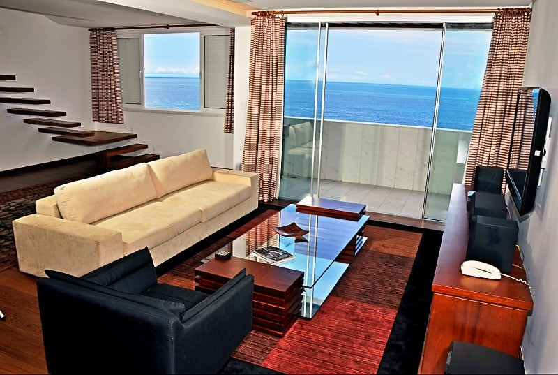 "10th floor living room with veranda, view of Atlantic, ""floating"" stairs"