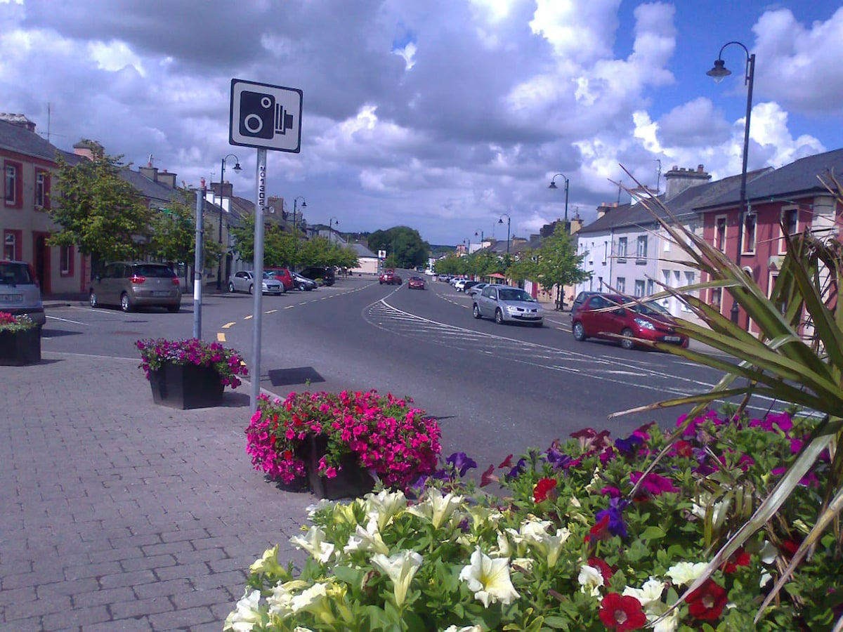 Balla, a warm welcome awaits visitors here, Trad music, pubs,  food and Historical monuments