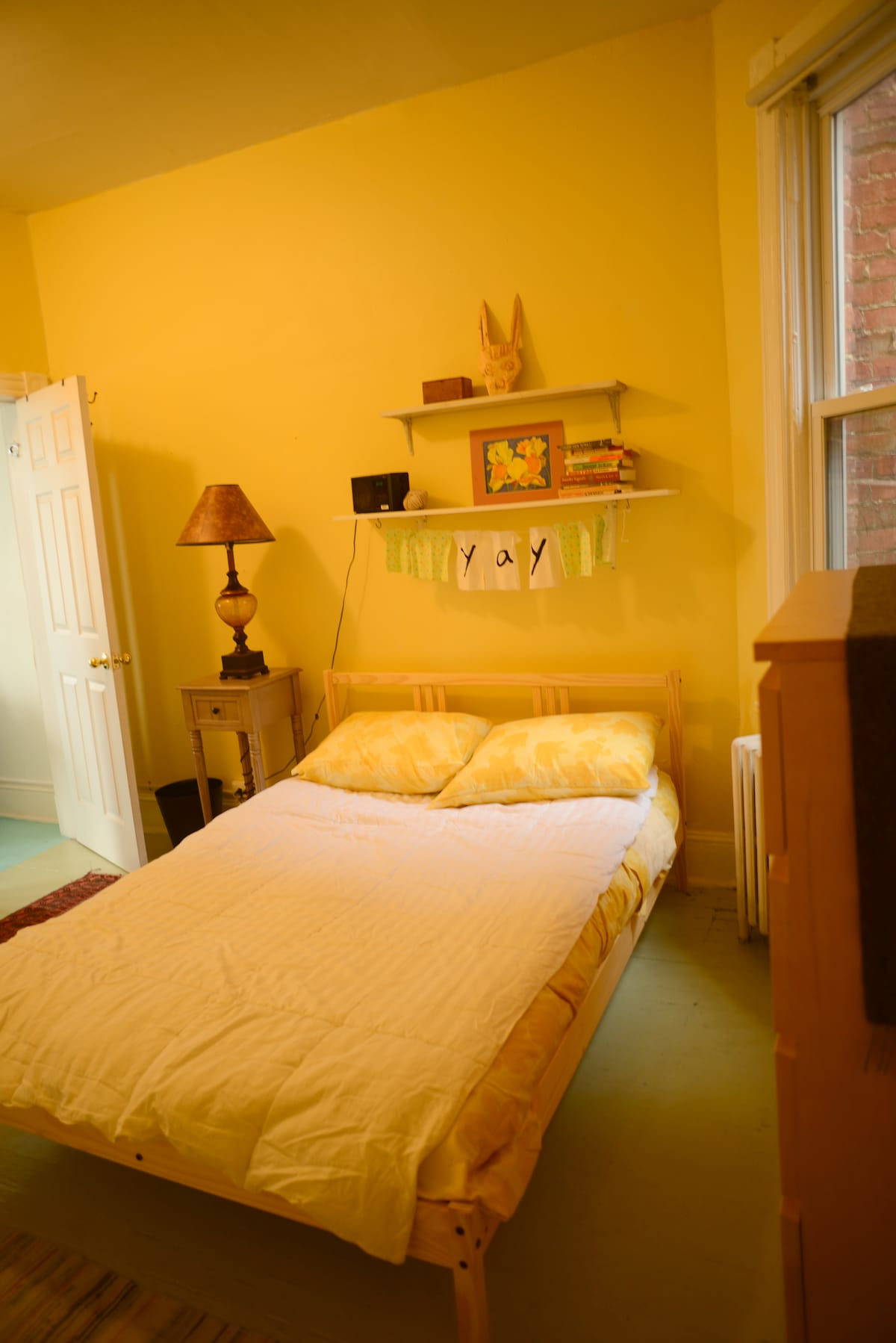 Quaint front bedroom has full sized mattress and easily the best morning light in the whole house.