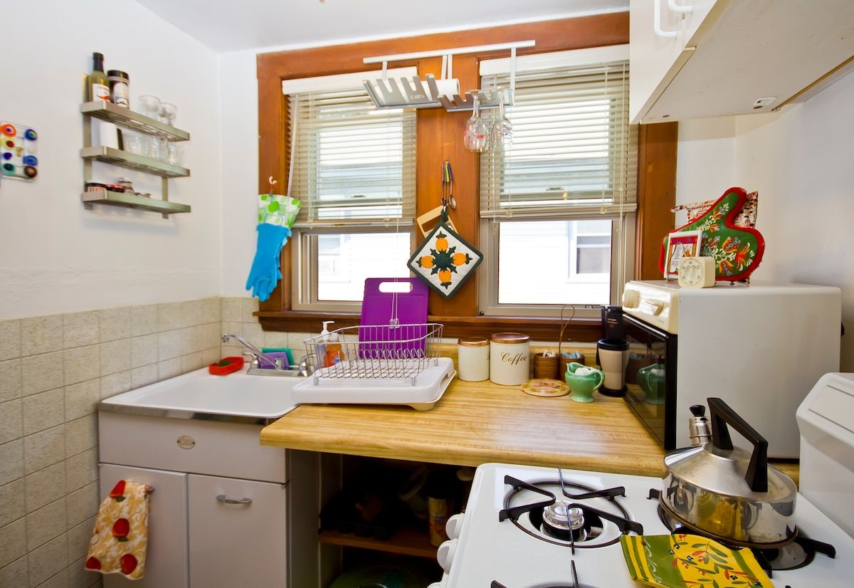 Fully equipped kitchen with stove, oven, microwave, coffee maker, and toaster