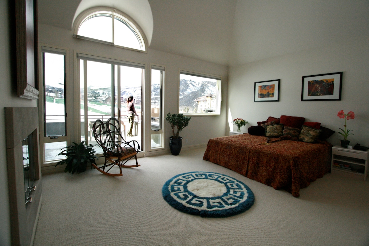 """Master Bedroom.  3rd floor.  Fireplace.  Private balcony.  52"""" flatscreen.  AMAZING view of Mt. Daily."""