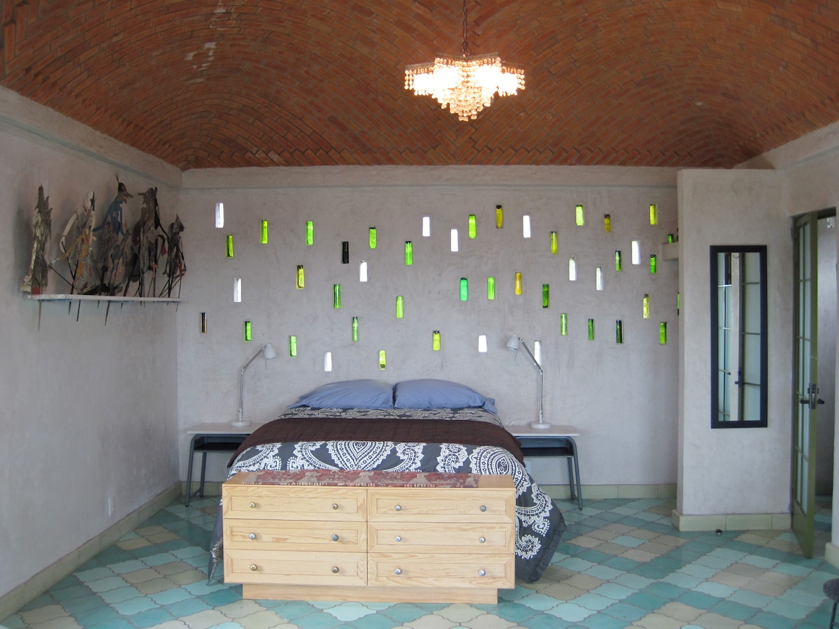 Queen bed under an amazing brick dome ceiling called a Bovada, specific to Guanajuato.
